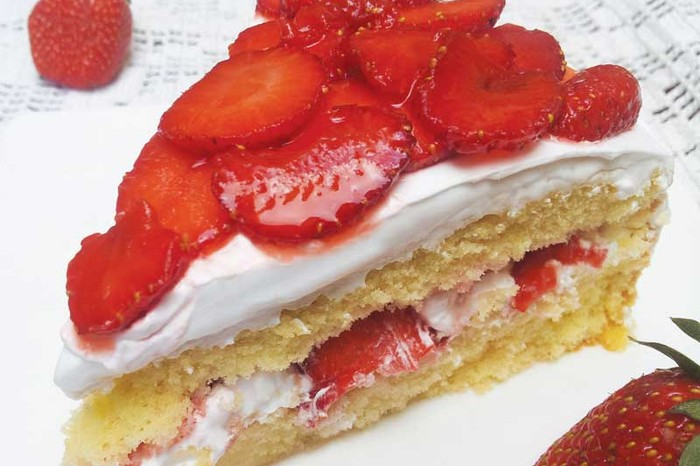 Strawberry Genoise Cake layered with strawberries and whipped cream