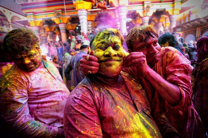 People lathered in colours celebrate Holi in India