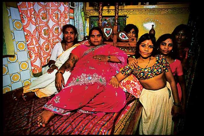 A madam of one of the more expensive houses with her girls.