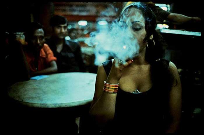 Transvestite smoking in the Olympia Cafe.