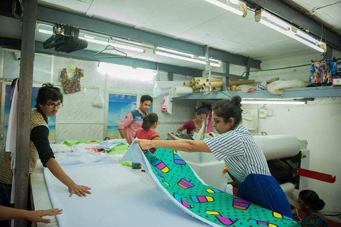 Shweta working with local taxi fabric tailors