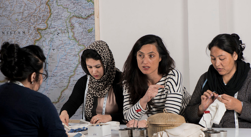 Iris Strill with Afghan women talking at Silaiwali