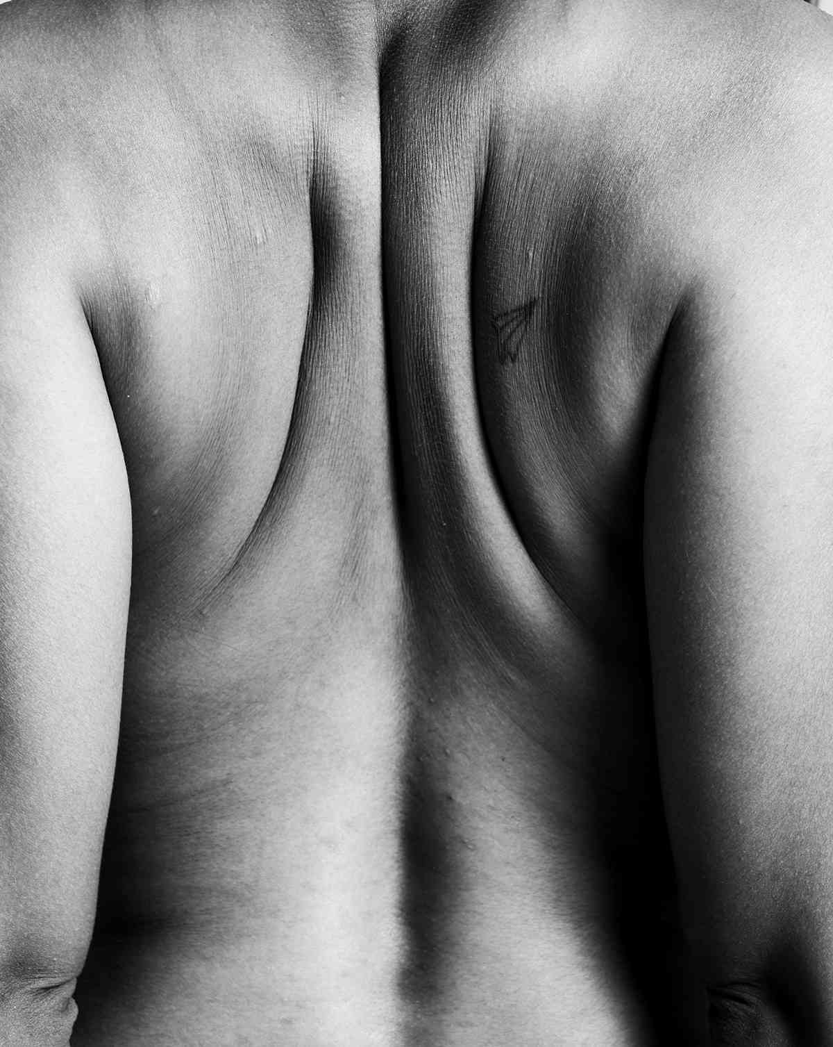 Close up image of human back to depict symmetry