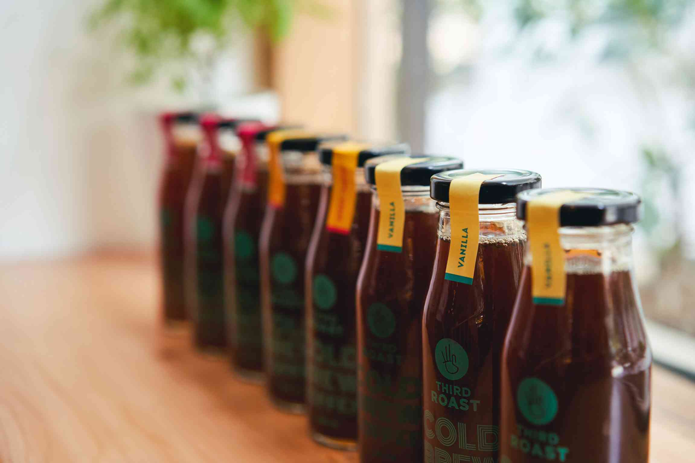 bottles of signature black cold brew coffee from third roast coffee