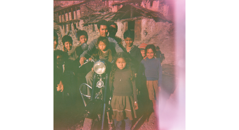 Circa 1996, Dharam Singh (35 year old) on a tourists' bike with his son Vinod seated in front and daughter Bina along with other village children.