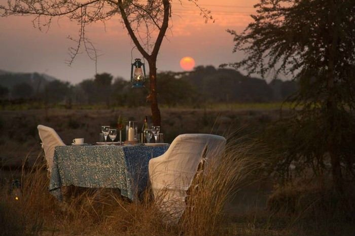 You can enjoy a quiet dinner out in the open. Khem Villas, Rajasthan