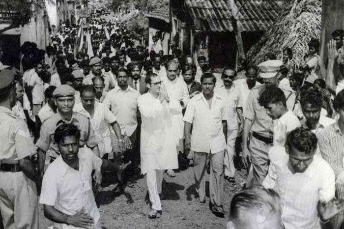 Sanjay Gandhi, said to be inspecting a slum Image Source: Guruprasad