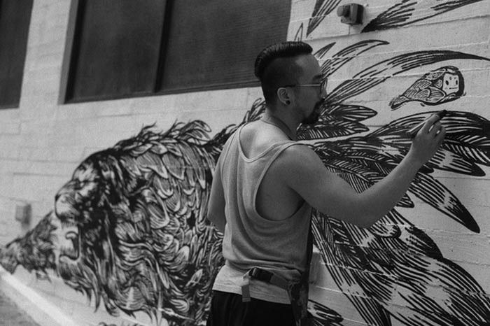 Artist Kristopher Ho using AIR-INK to beautify a public space in Hong Kong.