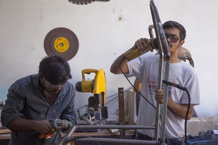 Team Fl'air welding the flying wheel chair. Photographed by Rashi Arora for Homegrown