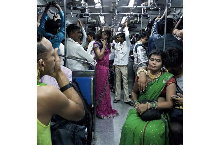 """""""Samaira, a trans friend of mine, poses for a picture in the general compartment of the Mumbai local train. Apurva, also a transgender, can be seen in the foreground with her friend."""""""