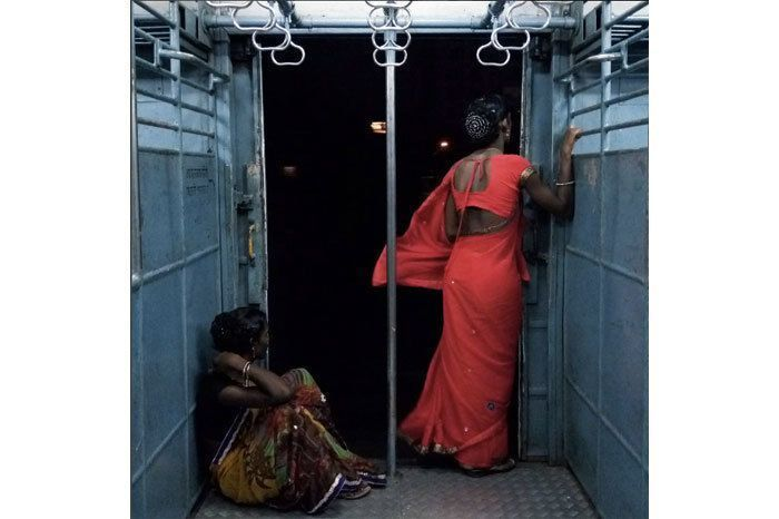 """""""Gugan (R) and Sneha (L) who identify themselves as transgenders travel in the ladies compartment of the Mumbai local train. Gugan told me that she doesn't remember her parents but her Guru is now her parent. She says that whatever they earn they give it to Guru and the Guru gives her money to buy make -up and clothes to dress up. She told me usually the Guru makes food in the morning and feed their followers like how parents first feed their children and then eat themselves. I asked her whether some people from their community stay with parents and she questioned me back asking what if I had child who was born as a hijra ,what would I do? I replied I will take care of it as my own and she retorted back saying no you will not ,you will leave it to fend for itself and to that I said never .Then she said that you don't have to worry the seniors in the Hijra community usually come to know if any such children are born in any hospital to any parents and if that is the case then they bring the child and raise it as their own . I don't know what I would really do. I answered her at that moment without thinking but I really want to know what would you all do?"""""""