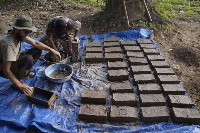 Making mud bricks at the farm; source: Peepal Farm