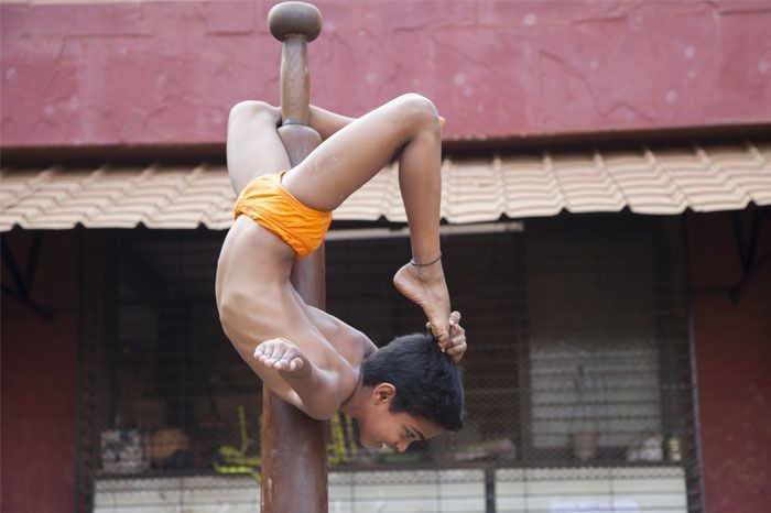 A young boy practising Mallakhamb. Photographed by Rashi Arora for Homegrown