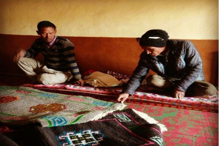 Mr. Tapka and his colleague shows me the various handicrafts made by the villagers