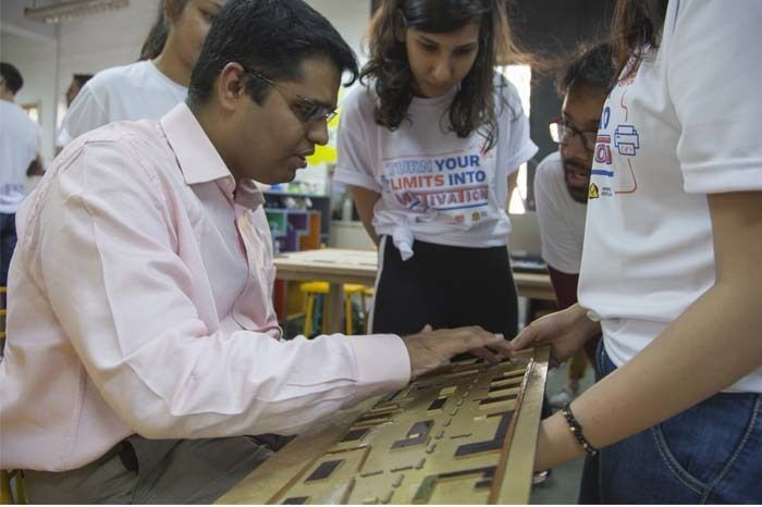 A Visually Impaired man reads the braille on the Samples.Photographed by Rashi Arora for Homegrown
