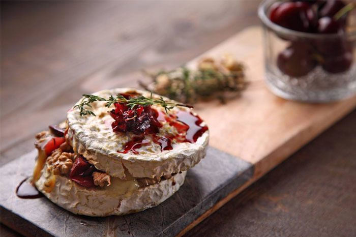 Baked Brie with Cherries ,Walnuts and fresh Thyme; courtesy of The Spotted Cow Fromagerie