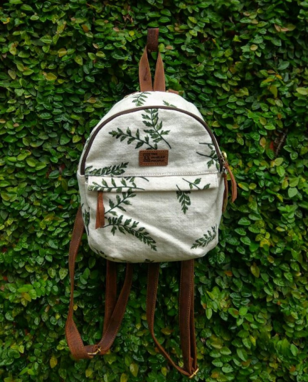 A burlap bag against green leaves