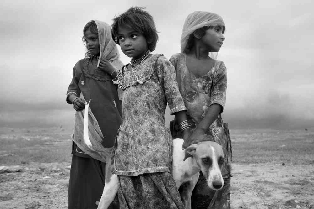 Children of the Kalbelia tribe, photographed by Christian Stejskal