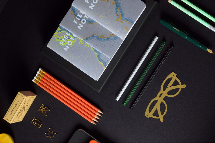 Black table set with field notes notebook, pens, pencils and bookmark from indian stationery brand chapter and ink