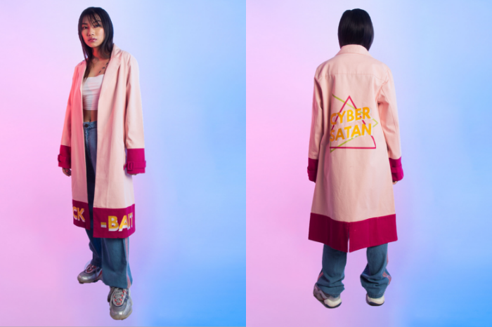 Woman wearing pink street wear style long jacket with click bait and cyber satan written on it from SIX5SIX