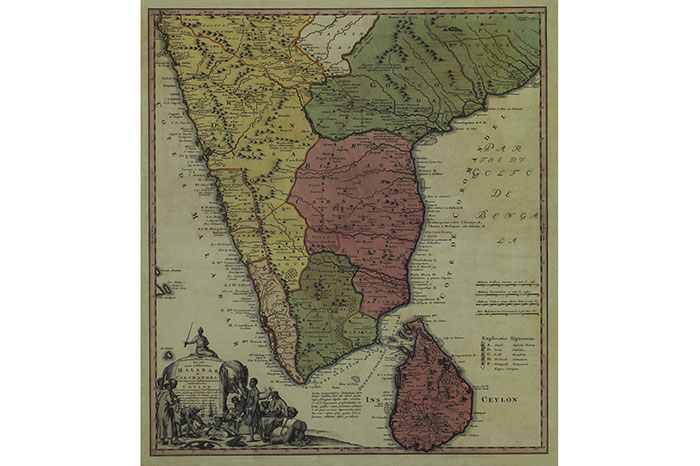 A political map of Southern India demarcating the Malabar and Coromandel coasts and the wider regions are distinguished with pink, green, yellow and white and are bordered with darker tones of respective shades. The title of the map is written on the saddle cloth of an elephant driven by a mahout, while a scene of trade exchange between the natives and perhaps Arabs take place. Artist -- Johann Baptist Homann