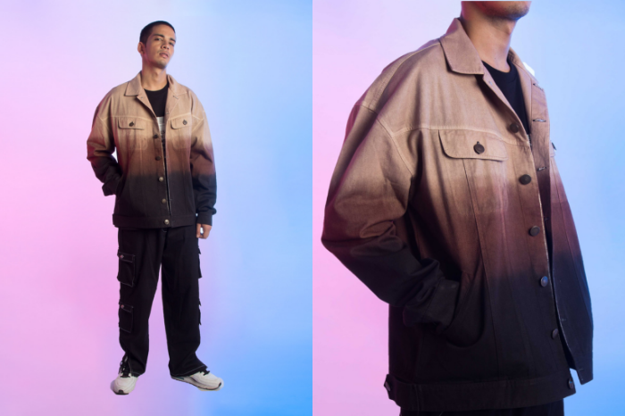 Man wearing black, brown and tan outfit with jacket and cargo pants from street wear brand SIX5SIX
