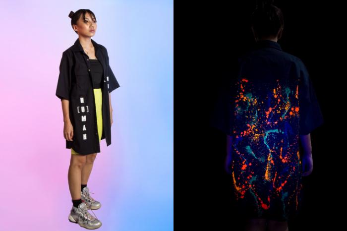 Woman wearing black jacket with glow in the dark details from street wear brand SIX5SIX