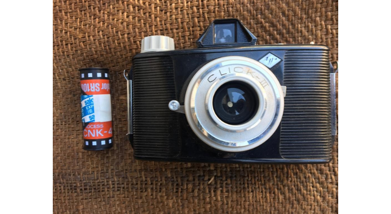 Agfa Click III point & shoot camera and the Sakuracolor SR100 colour roll removed from it.